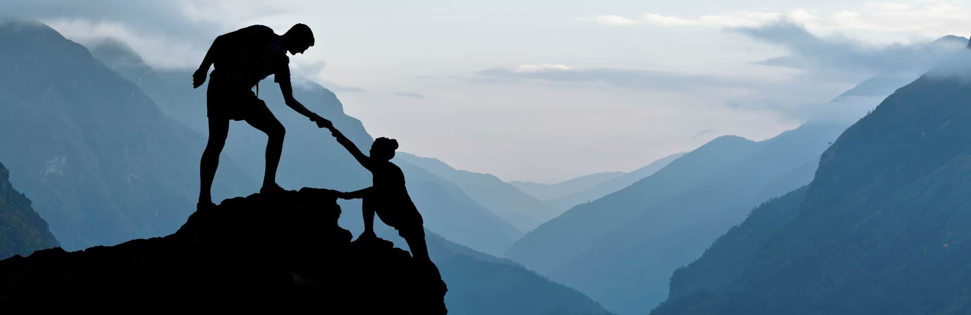 Picture of trust - a couple on a mountain
