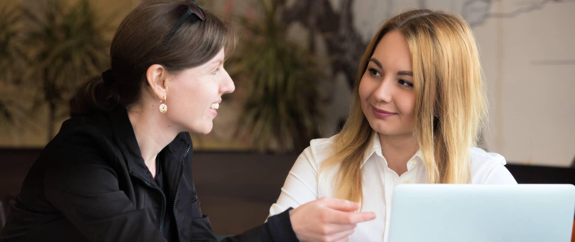 Women in a 1-2-1 meeting